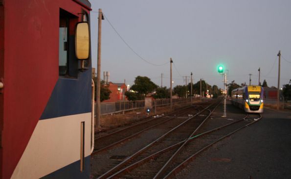 N467 awaits departure from South Geelong on the down, VLocity in the siding