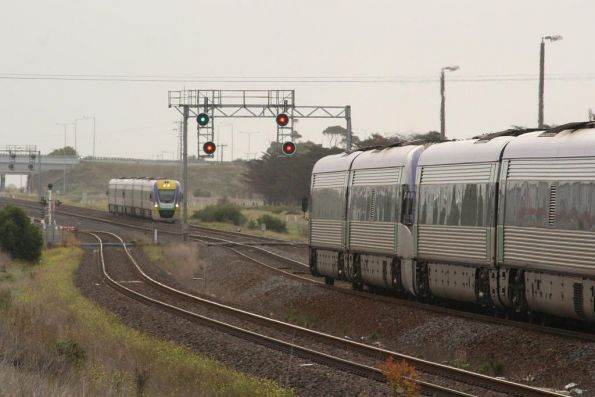 Two VLocity consists pass by at Corio