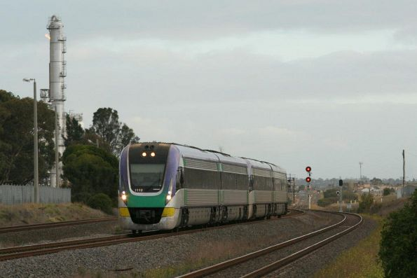 VL12 leads a classmate out of Corio