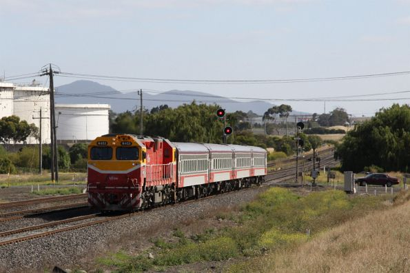 N453 passing the oil tanks of the Shell refinery at Corio