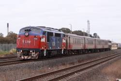 A60 off towards Melbourne with refurbished carriage set and power van