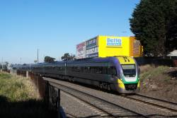 VLocity 3VL23 leads a classmate past Geelong Loco on the up