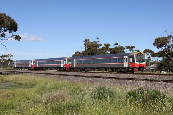 Trio of Sprinters lead by 7012 pass the site of Manor station