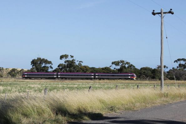 On the down at Manor, a solo 3-car VLocity heads for Geelong