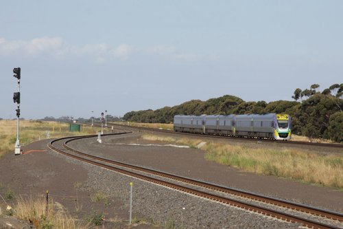 Future Manor Junction and a down Geelong service, one of two 7-car consists that run on the Geelong line in peak