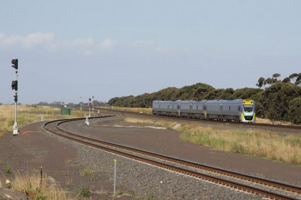 Future Manor Junction and a down Geelong service, one of two 7-car consists that run on the Geelong line in peak,
