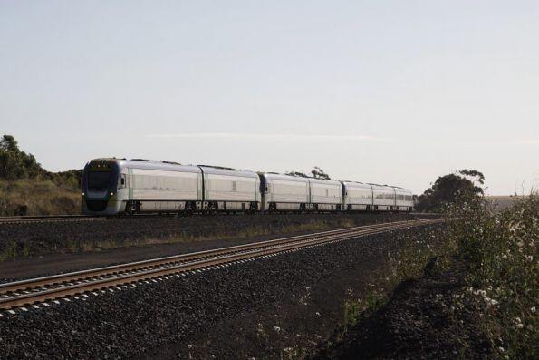 It isn't even 6:30pm yet, the second 7-car consist passes through Manor on the up, headed empty cars back to Melbourne