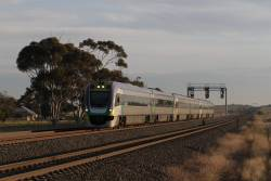 VL11 leads a trio of 2-car VLocity units on an up Geelong service at Manor