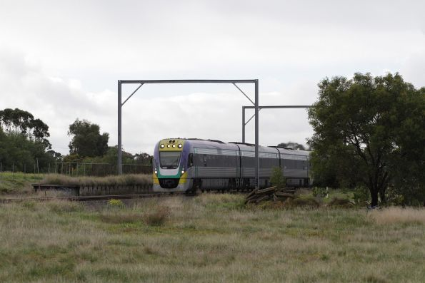 VLocity 3VL35 on a down Geelong service passes the remains of Werribee Racecourse station