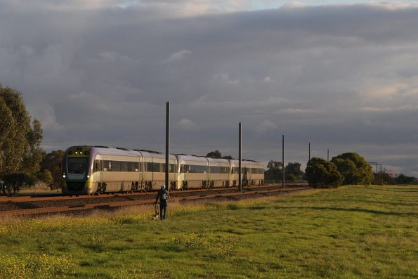 Trio of 2-car VLocity sets on an up Geelong service approach the suburban area at Werribee