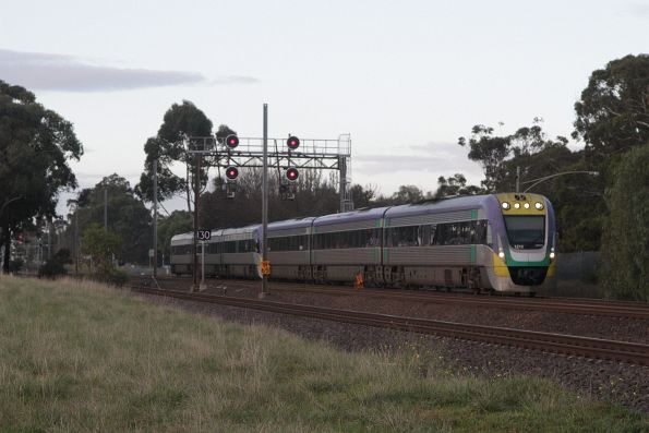 VLocity 3VL19 and classmate with a down Geelong service depart the suburban area at Werribee