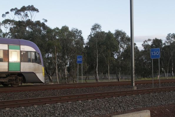 VLocity passes the 160 km/h speedboard on departing the suburban area at Werribee