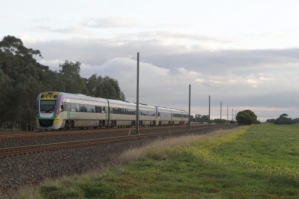 VLocity 3VL21 and classmate approach Werribee Racecourse with a down Geelong service