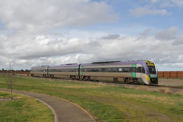 VLocity 3VL19 bound for Waurn Ponds station, skirting houses at Grovedale