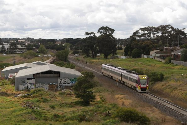 VLocity 3VL46 on a down Waurn Ponds service passes the former Geelong Racecourse platform