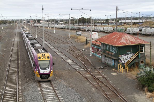 VLocity VL56 and classmate lead an up Geelong service past former signal box North Geelong A