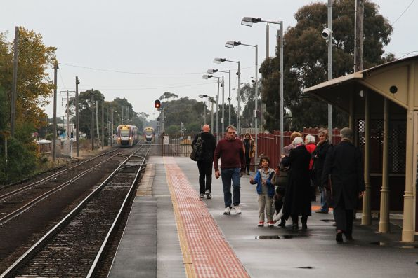 VLocity train approaches the platform at South Geelong ready to form an up train, as VL13 departs bound for Waurn Ponds