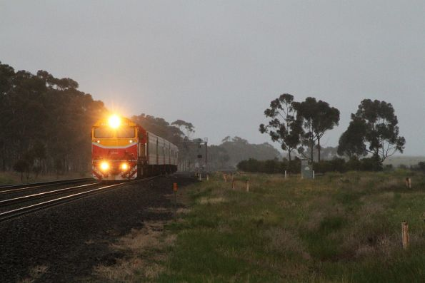 N465 leads the down Warrnambool service express through Little River