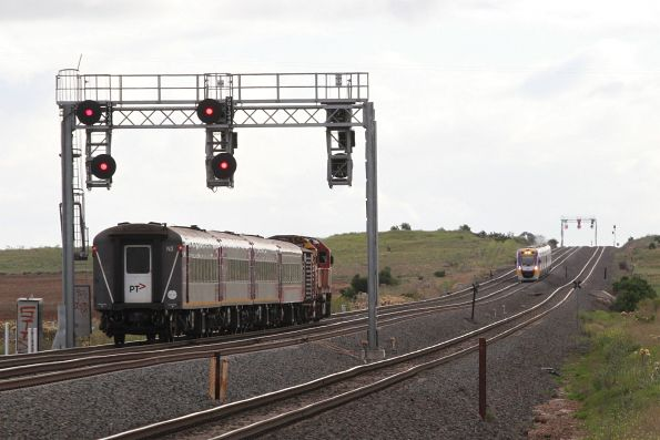 N460 leads carriage set N3, BTN carriage and a power van on a down Geelong service at Manor Junction