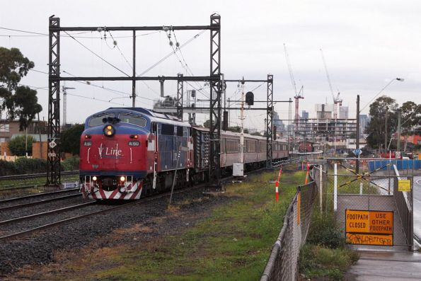 A60 leads the second-last A class hauled service, on the down at West Footscray
