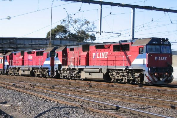 N472 and classmate double head a down Geelong service at Newport