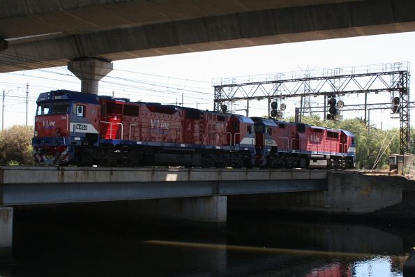 N453 and N457 head light engine over Moonee Ponds Creek at North Melbourne