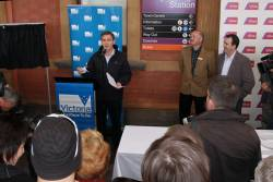 Premier Brumby addresses the crowd at Maryborough, beside V/Line CEO Rob Barnett and Minister Pakula