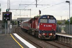 N472 leads a down Geelong service through Yarraville
