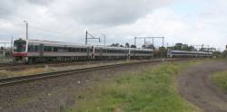 Triple Sprinters on a down Geelong train crosses paths with an up VLocity consist at Newport