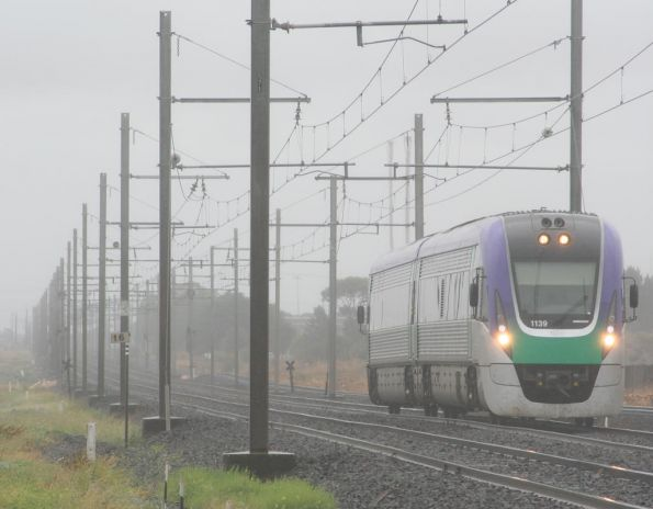 VLocity VL39 on an up Geelong in the rain at Kororoit Creek Road
