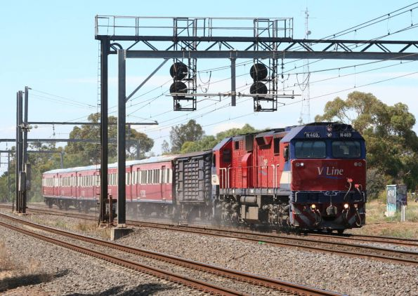 N469 with power van and H set stirs up the dust on the down at Werribee
