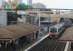 Sprinter train departs North Melbourne station, work begins on the new overhead concourse