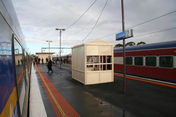 Up Geelong service stopped at Laverton station due to a sick passenger