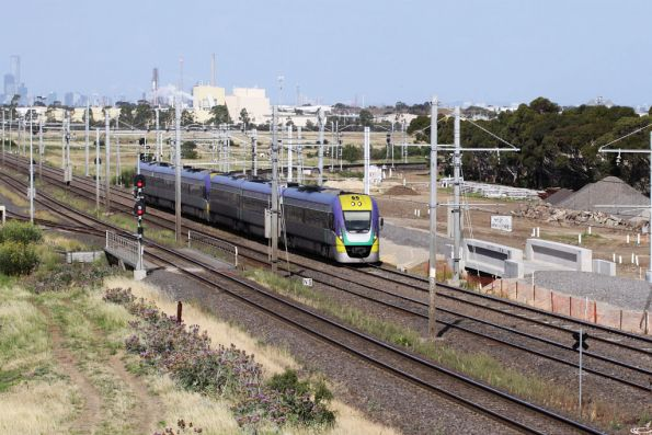 A pair of three car VLocities bound for Geelong pass the works at Laverton Junction