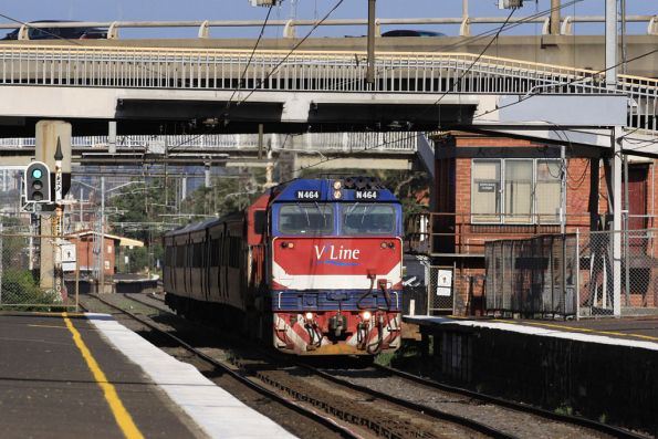 N464 heads a H set on a down service at West Footscray