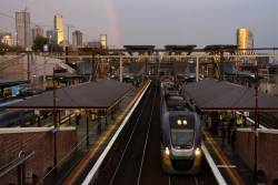 VLocity VL10 picks up passengers at North Melbourne as darkness falls