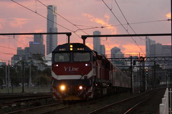 Sun sets over the CBD, as N463 leads a down Traralgon train into Richmond