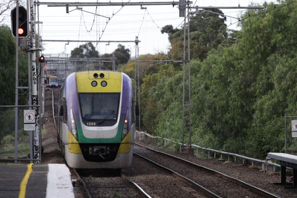 VLocity VL25 on up Geelong with the conductor on the PA approaching Footscray, running right behind a spark