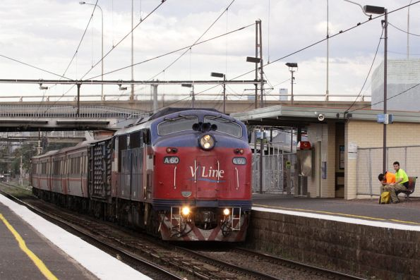 A60 leads a down Bacchus Marsh train through West Footscray