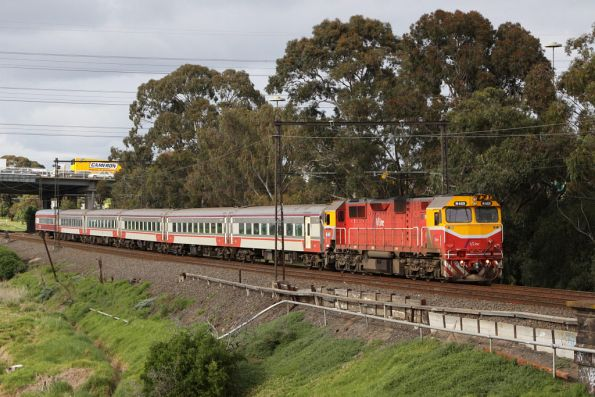 N469 leads set VN17 and extra carriage BCZ259 on the up at Yarraville