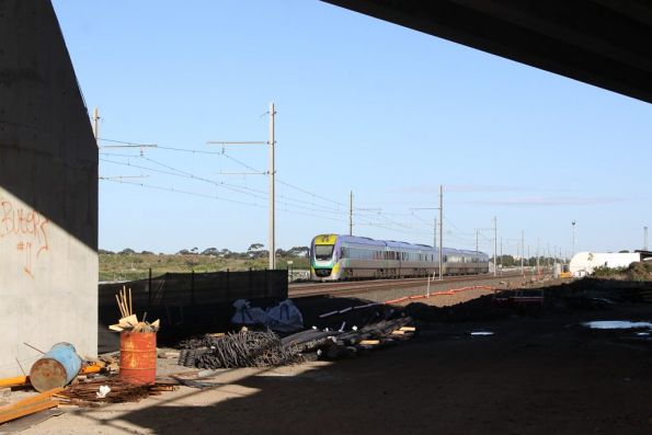 VLocity bound for Geelong passing under the new Kororoit Creek Road bridge