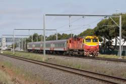 Down Geelong service led by N475 crawls to a halt outside Laverton station, having caught up to the spark ahead