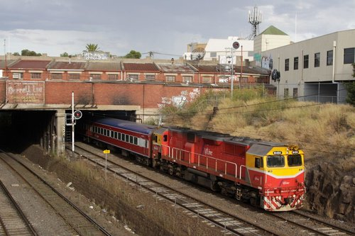 Passing under the Nicholson Street bridge, N454 leads the down Swan Hill train out of Footscray