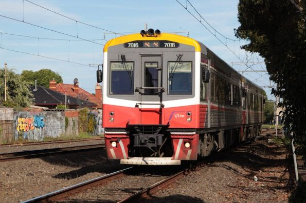 Sprinter 7016 and classmate on the down at Essendon