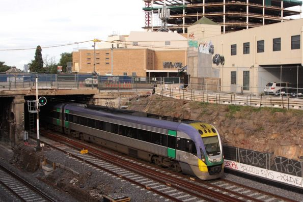 VLocity VL09 passes beneath the partially demolished Nicholson Street at Footscray