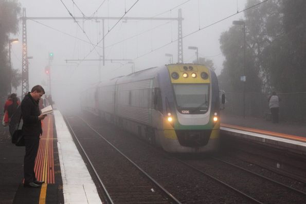 VLocity VL06 emerges from the fog, on the down at Newmarket station