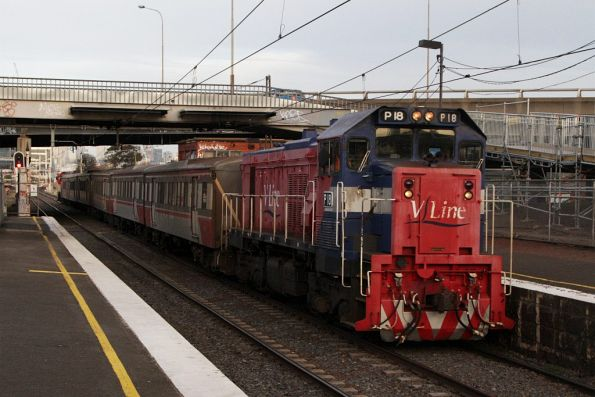 P18 leads a down push-pull service through West Footscray
