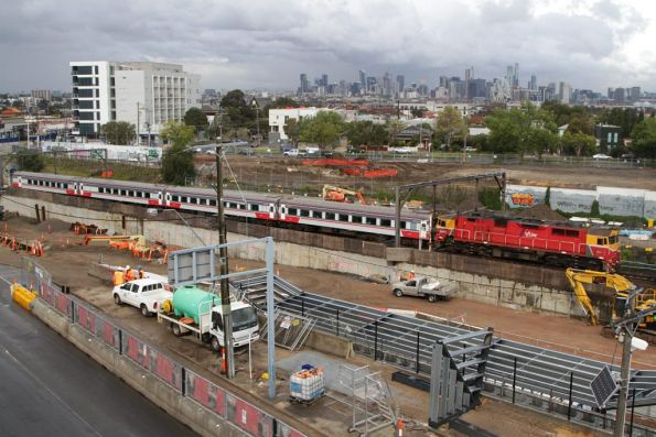 N469 leads a down Geelong service through Footscray