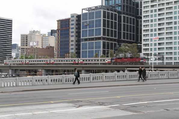 N465 leads a down Bairnsdale service across the viaduct towards Flinders Street Station
