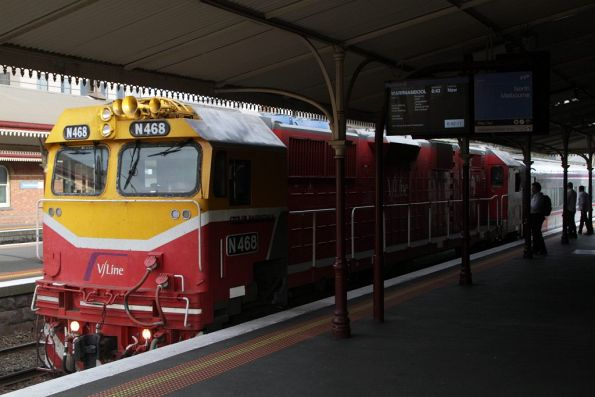 N468 on a down Warrnambool service stops for passengers at North Melbourne station